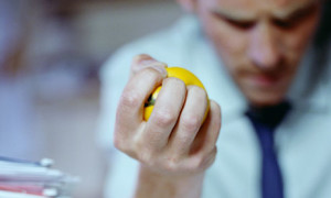 Man squeezing stressball
