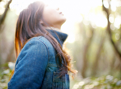 Young Woman Looking Up at Sky